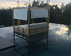 Day bed in pool at Camiral